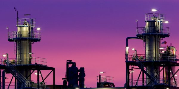 Chemical plant at sunrise with dramatic colors